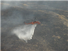 Helicopter Controlling the Fire with Water