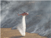 Helicopter Spraying Water Close to a Fire