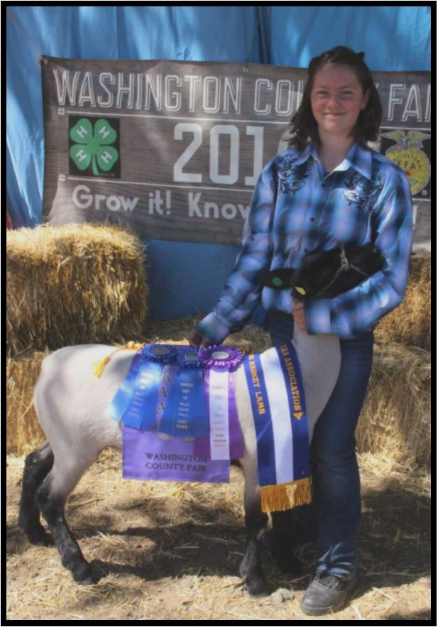 Sage Griffin with her Champion Goat